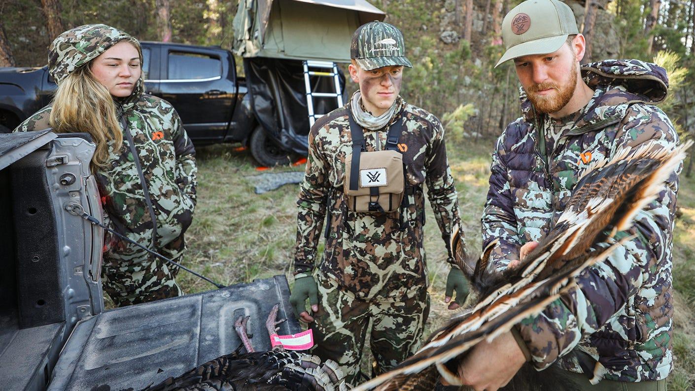 Hunter mentoring new hunter on turkey hunting.