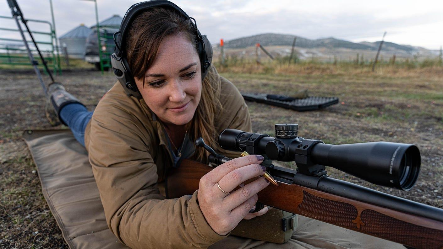 Katie Marchetti practicing rifle skills at the range.