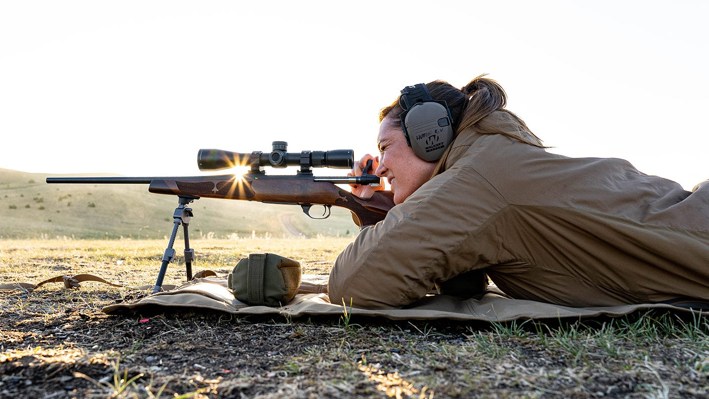 Katie Marchetti rifle hunting in the field.