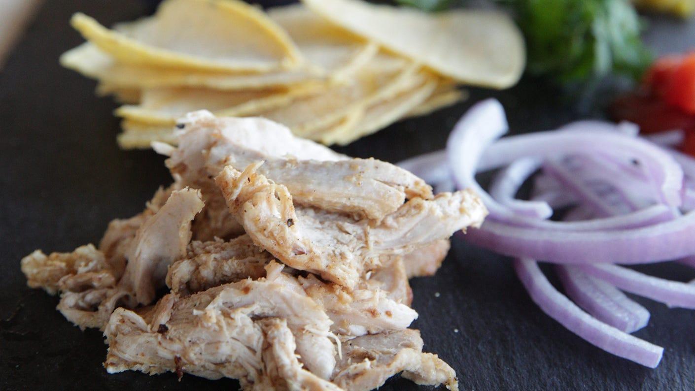 Shredded dove and sliced vegetables on the platter