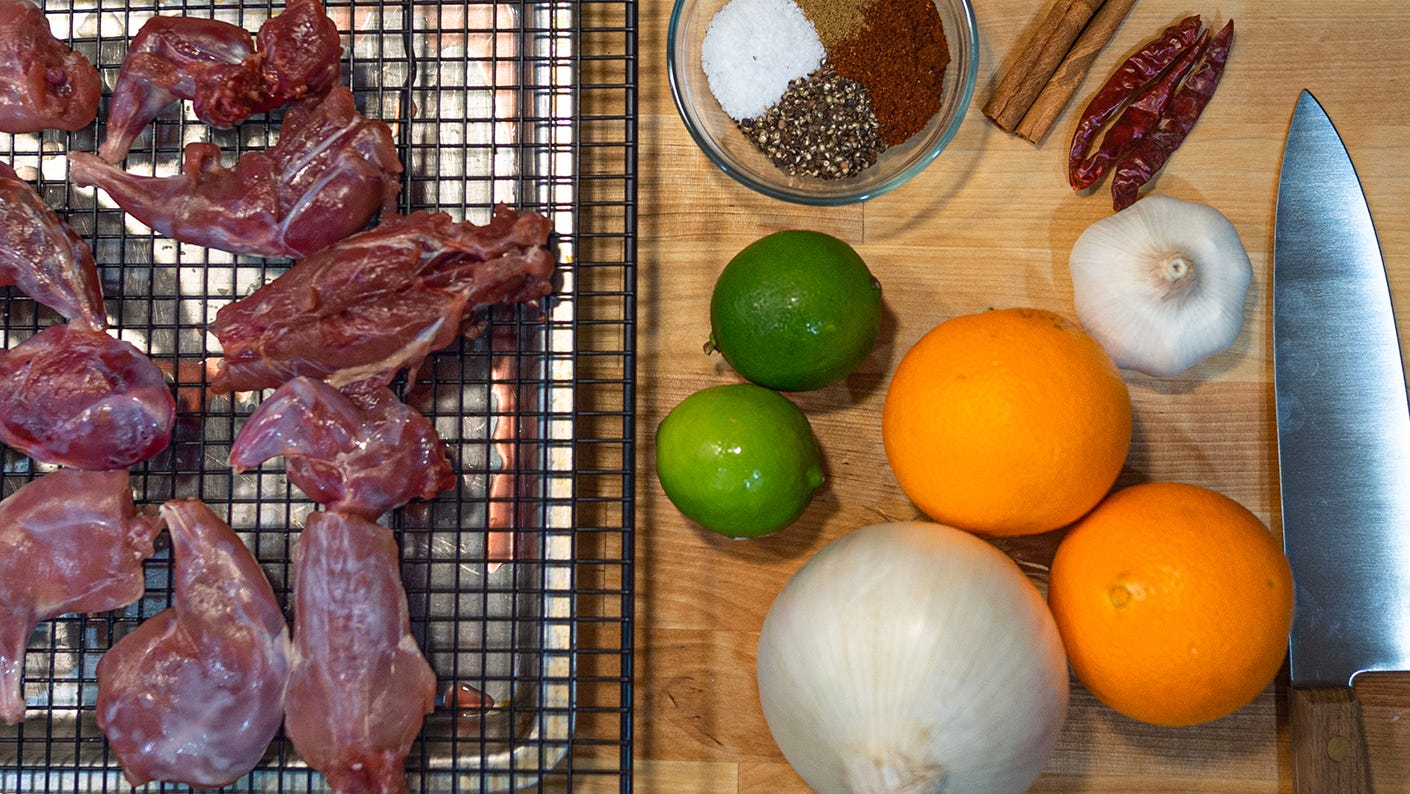 Squirrel parts, oranges, limes and knives.